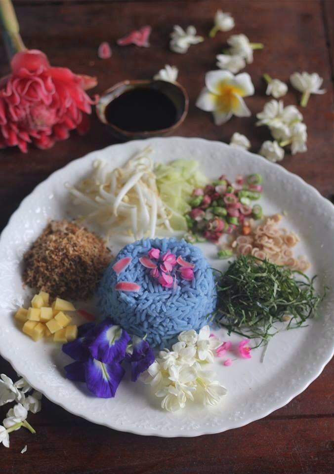 Khao yam Rice served with Thai herbs as lemongrass , coconut , kaffir leaves ... Blue rice cook from butterfly pea flower. Visit Blue lagoon Koh chang Thai Cooking School for this ...!