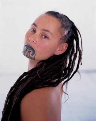 """Maori women also went through the process of obtaining moko, although they were limited to the area of the chin, lips, above the upper lip, and occasionally between the eyes, buttocks genitals, back and legs."" Info quoted from: http://www.themaori.com/maori-tattoo/moko-meaning  Photography by Hans Neleman from his photography series of Maori portraits which can be seen at the PEM: http://www.pem.org/exhibitions/2-body_politics_maori_tattoo_today"
