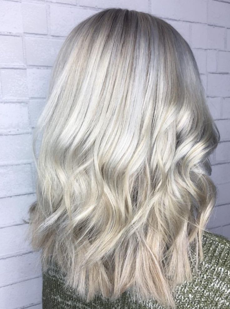 Silver hair color and textured lob, love!