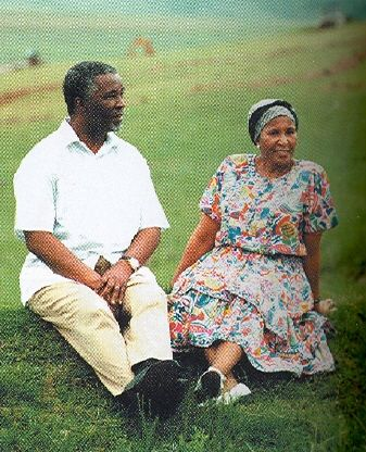 Thabo and Zanele Mbeki outside Epainette Mbeki's house at Ngcingwane, 1999
