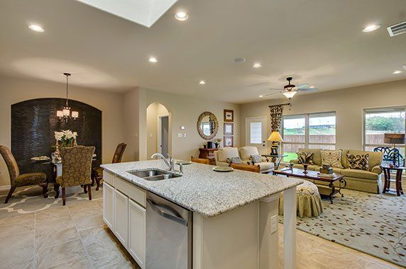 Beautiful open concept kitchen with great natural light looking out over the living room and back yard. Located in Shertz.
