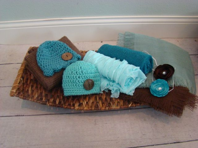 Our NEW medium brown Rattan weave basket ray  * Teal Sunhat, and teal boys hat  * Cocoa brown mohair drape/wrap  * Brown burlap throw/ layer  * Teal and brown flower headbands  * Seafoam colored burlap/layer  * Soft teal ruffle wrap Great set for newborn boys or girls!  $159.95    Buy It!