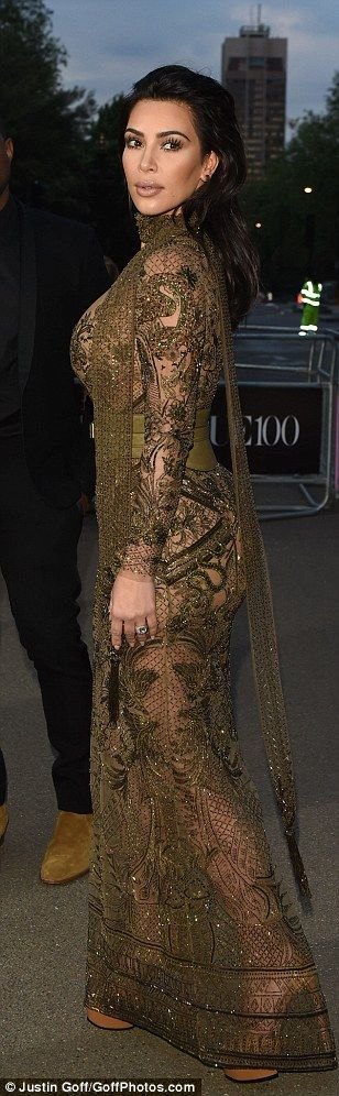 Kim Kar-flashian! Reality TV queen flaunts her famous figure in VERY revealing khaki dress as she steals the show at star-studded Vogue 100 gala dinner in London | Daily Mail Online