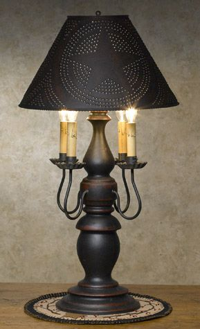 I have a bunch of wooden lamps to do.Maybe I can figure out a way to attach candle lights like this.