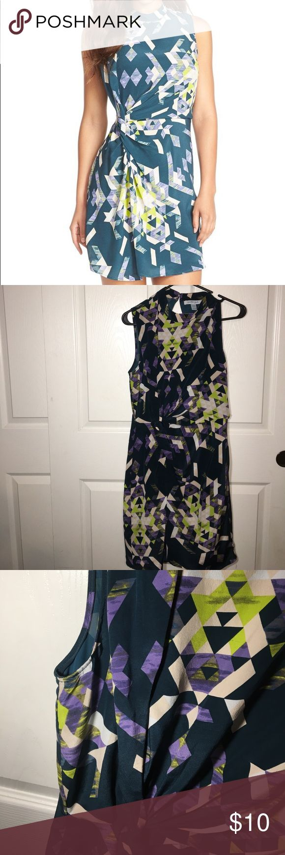 Charlie Jade Dress Beautiful patterned dress. Hunter green, lime green, Beige and purple colors in dress. Missing the bottoms clip to hook in the back where dress connects at neck. Easy fix . charlie jade Dresses Mini