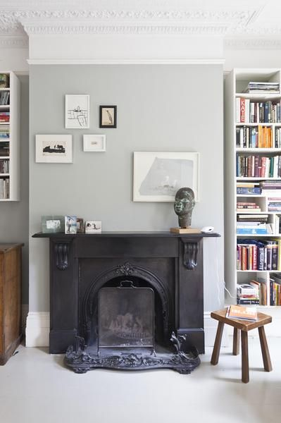 love that fireplace and unexpected art arrangement