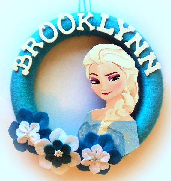 Dress up the door with this Frozen wreath. | 26 Ideas For The Ultimate Disney Princess Bedroom