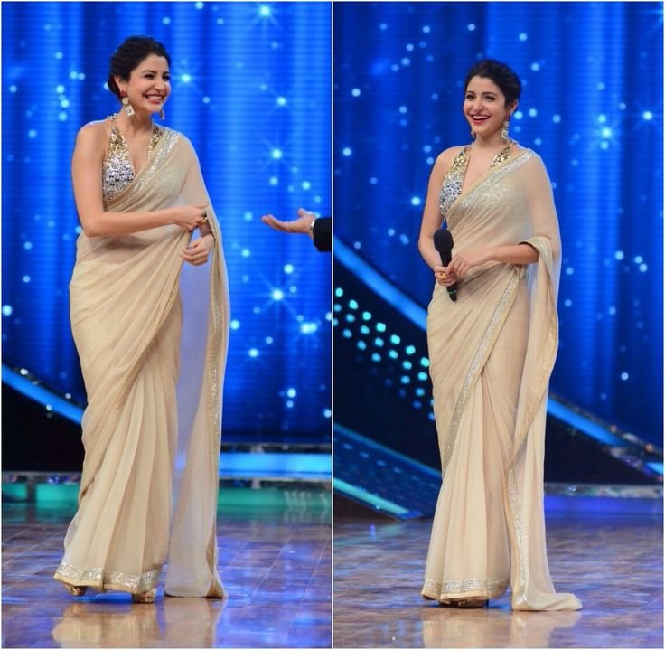 DIVINE DAZZLE  Anushka Sharma was a shimmering vision as she appeared on ‪#‎NachBaliye‬ clad in Abu Jani Sandeep Khosla The actress teams a halter gun metal blouse with a sequinned border Saree in earthy beige.
