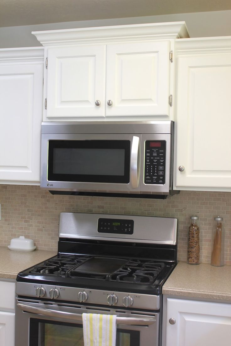 Add Dimension Over Microwave. Kitchen Remodel: Big Results On A Not So Big  Budget   Staggered Cabinets, Crown Molding To Factory Cabinets, ...