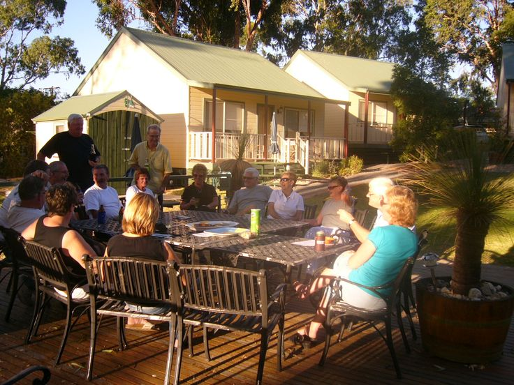 Spacious outdoor dining under the river gums.