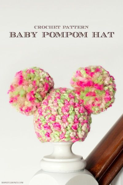Sugarplum Pom Pom Baby Hat - This crochet baby hat pattern features big, soft pom-pom ears that remind us of a certain magical mouse. This sweet little crochet baby hat will look so cute and spiffy this winter!