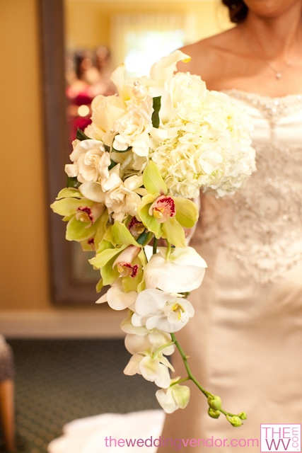 White and green wedding bouquet from www.TheWV.com. Hydrangea, roses, cymbidium orchids, dendrobium orchids