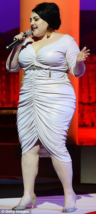 Showing off her curves: Beth teamed her dress- which featured a Monroe-like plunging neckline and three-quarter length sleeves- with gold kitten heels