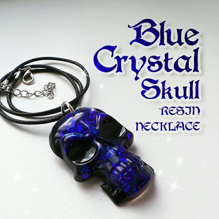 My new gothic style resin necklace. Beautiful blue faux-crystal skull 💀💙