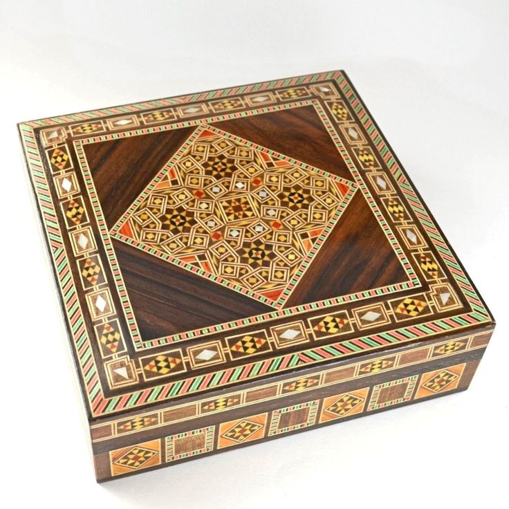 This amazing mosaic wooden box comes from Syria, and the ancient tradition of wood inlay. Beginning in Damascus, the technique has been perfected over hundreds of years. Artisans carefully cut and sha