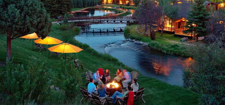 Tell ghost stories creekside by the campfire with family at the Rustic Inn in Jackson Hole