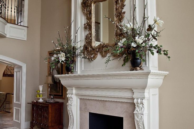 Elegant fireplace design with ornate gold mirror cost for New construction fireplace