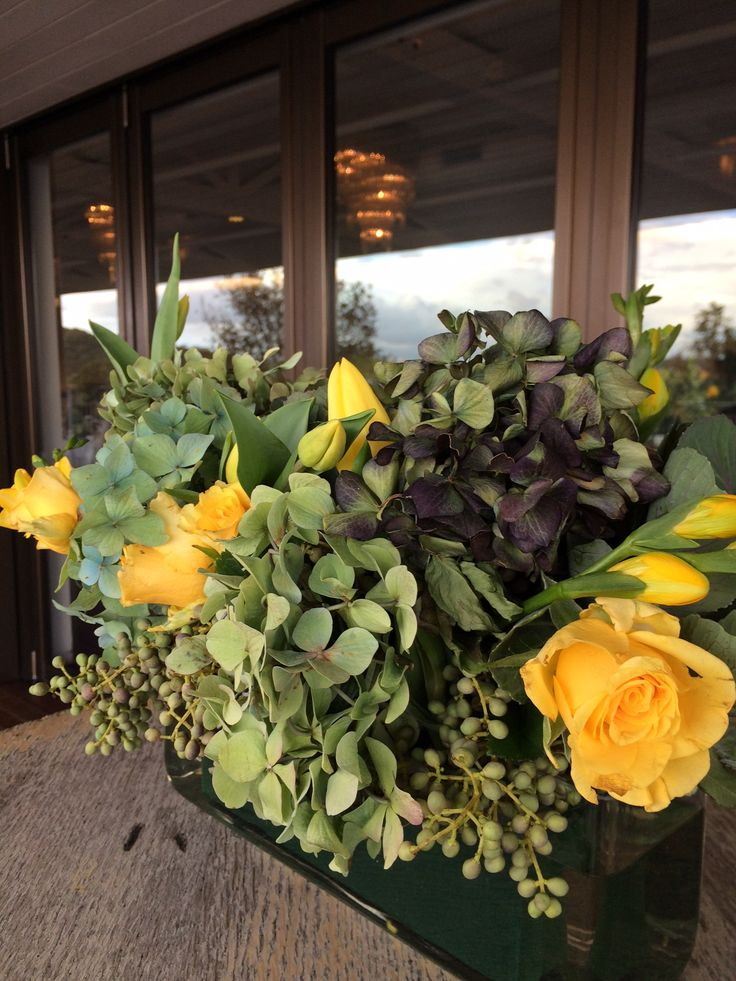 Masculine Corporate Yellow and Green Floral Centrepieces Rose Hydrangea Tulips Fresias Berries