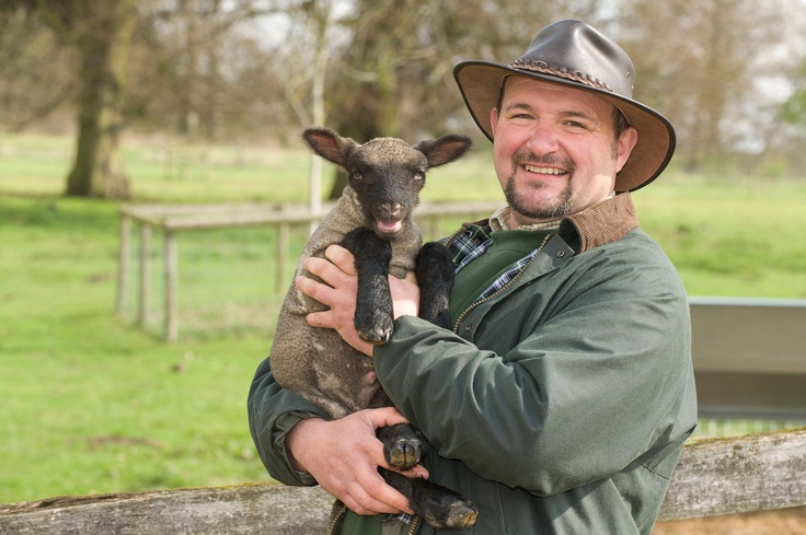 Ian, our Countryside Manager, aka Farmer Pickles with one of our new born lambs down at Northycote.