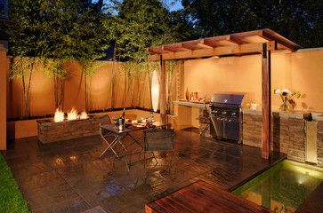 13 Upgrades For Your Outdoor Grill Area: Set a mood at night with lighting. A combination of landscape lighting and direct lighting over the grill area will offer the right balance of function and ambience.