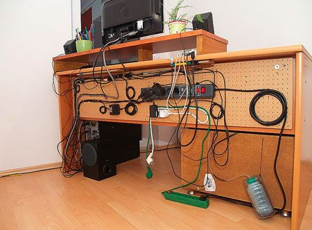 cord management: pegboard nailed to back of desk  plastic pegboard locks to keep the cables in place