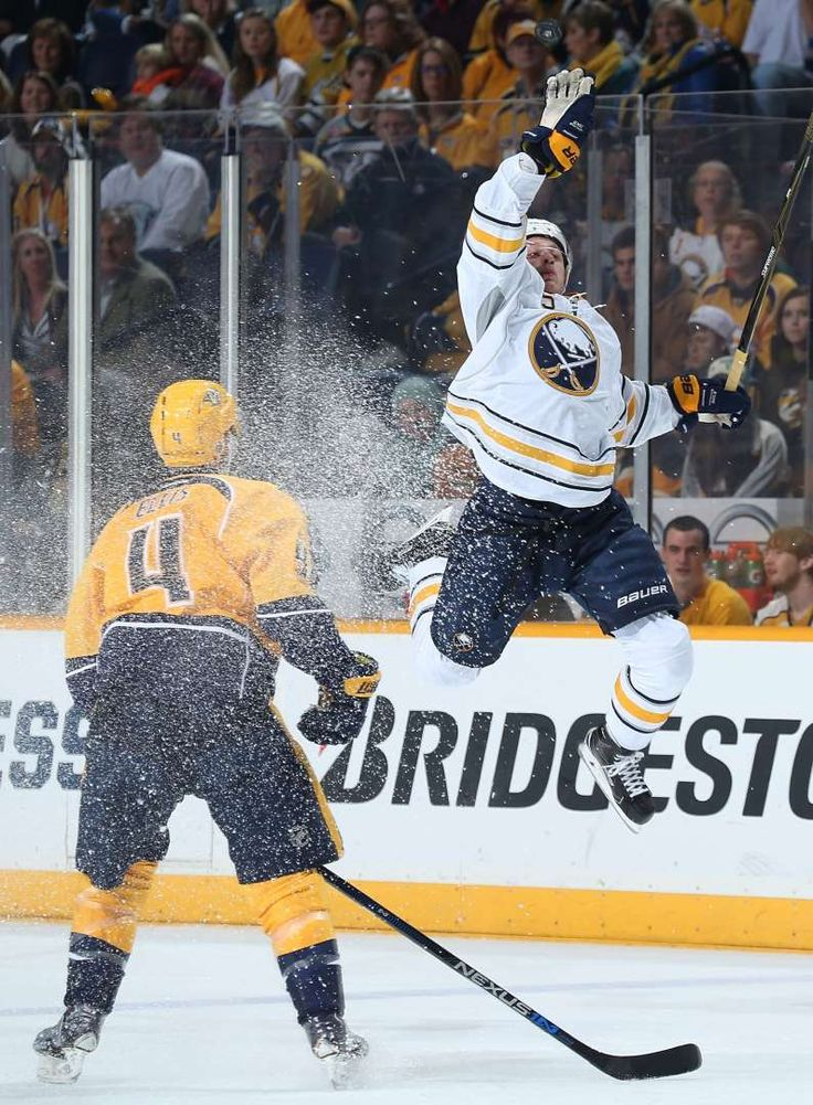 Getting air:   Jack Eichel, right, of the Buffalo Sabres leaps for the puck against Ryan Ellis of the Nashville Predators at Bridgestone Arena on Nov. 28 in Nashville, Tenn. -   © John Russell/NHLI/Getty Images