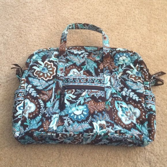 Vera Bradley travel bag In excellent condition. Only used once or twice. The outside long strap is missing but it has the handles at the top. Vera Bradley Bags Travel Bags