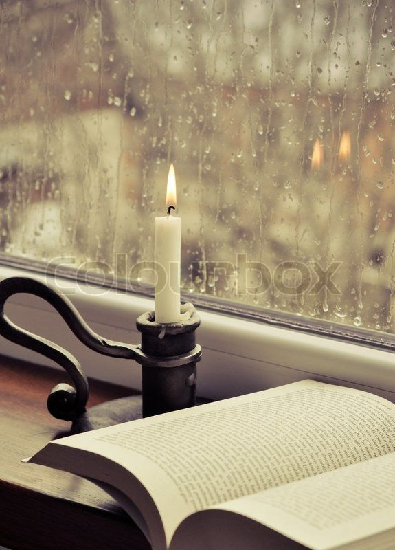 A book and a candle on a rainy day   Stock Photo   Colourbox on Colourbox