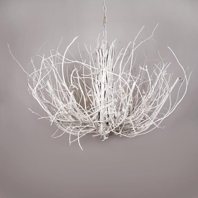 Spray paint an existing chandelier white along with a mass of thin, flexible branches.  Cover the chandelier in branches using clear or white zip ties and string to secure them.  {Steer clear of light bulbs.}  Follow the lines of the original chandelier to keep the form looking chandy-ish.