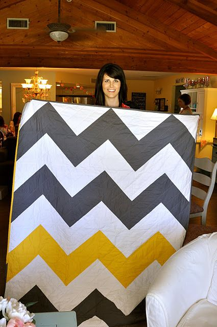 "chevron quilt: For this throw-size quilt, I cut 10"" squares out of white and gray and yellow fabrics, then followed my usual chevron routine*. WHAT TO CUT: This quilt is 6 half-square-triangle blocks across x 8 hst blocks down. Which means I cut 48 10"" squares total: 24 white, 18 gray, 6 yellow."