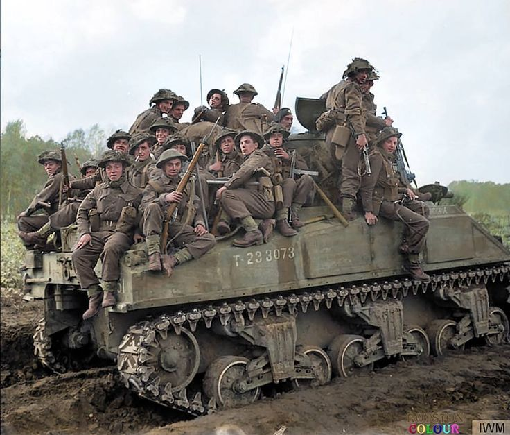 "OPERATION COLIN, BATTLE OF MAAS. Infantry of the 153rd Brigade, 51st Highland Division are carried into battle aboard a Sherman tank (T-233073) near Udenhout in the Netherlands. 29th of October 1944. **(additional info - this is the M4.Sherman Mk.I ""India"" of B Sqn. 1Tp - 1st Northamptonshire Yeomanry, 33rd Armoured Brigade)**"