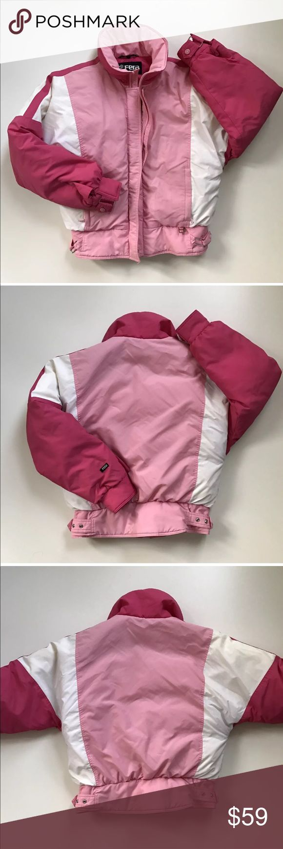 Vintage FERA Down Ski Jacket Women's Pink White This listing is for a vintage FERA down ski jacket. A mix of pinks with white. Features a zip up and snap front closure. Adjustable snap buckles at the hem. Inside zip up pocket. Retro design. Two outside front full zip pockets. Has a down fill and a nylon shell & lining. Size 12. Please note: some vintage sizes do not reflect modern sizes. Measurements taken with item laying flat and fully zipped close. Chest: 22 inches straight across Length…