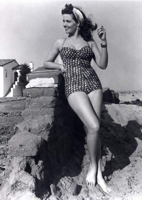 """Jane Russell.  Producer Howard Hughes (producer of """"The Outlaw"""" which propelled Jane Russell to sex symbol fame) said this: """"There are two good reasons why men go to see her. Those are enough."""" Hmmm...Her captivating eyes, Mr. Hughes?"""