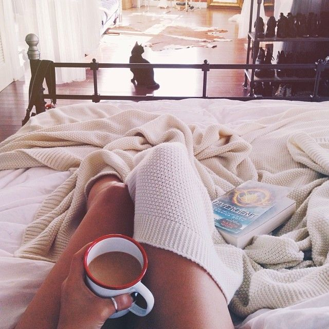 cozy up in bed with coffee