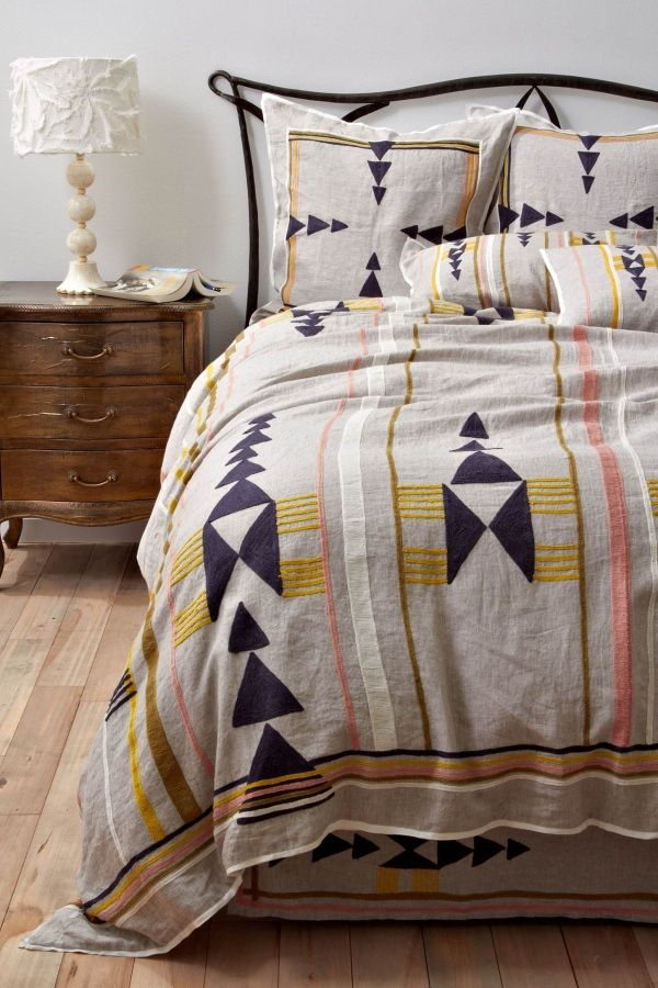 Tribal Pattern love! Or just plain white linens with tribal print throw blanket and decorative pillows