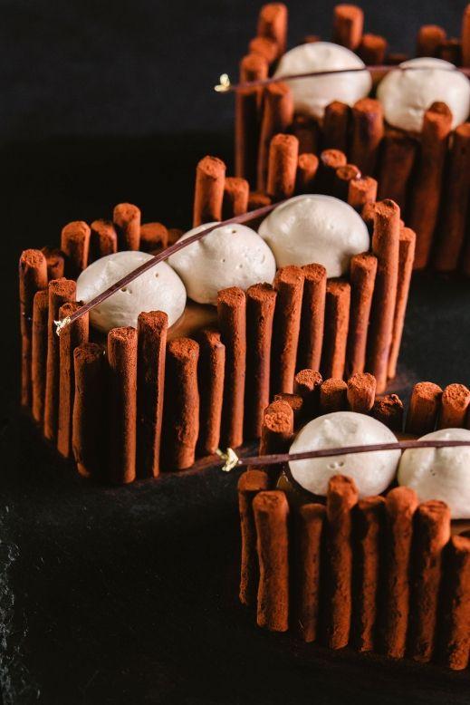 "Individual cake ""Passionata"". Composition: chocolate sponge cake; ganache with passion fruit; marmalade with mango and passion fruit; chocolate mirror glasage; chocolate whipped cream and jasmine tea truffles for decoration. By Nina Tarasova"