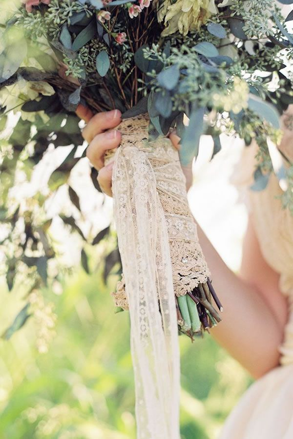 top off a vintage style bouquet with lace   wendy laurel photography   via: wedding wire