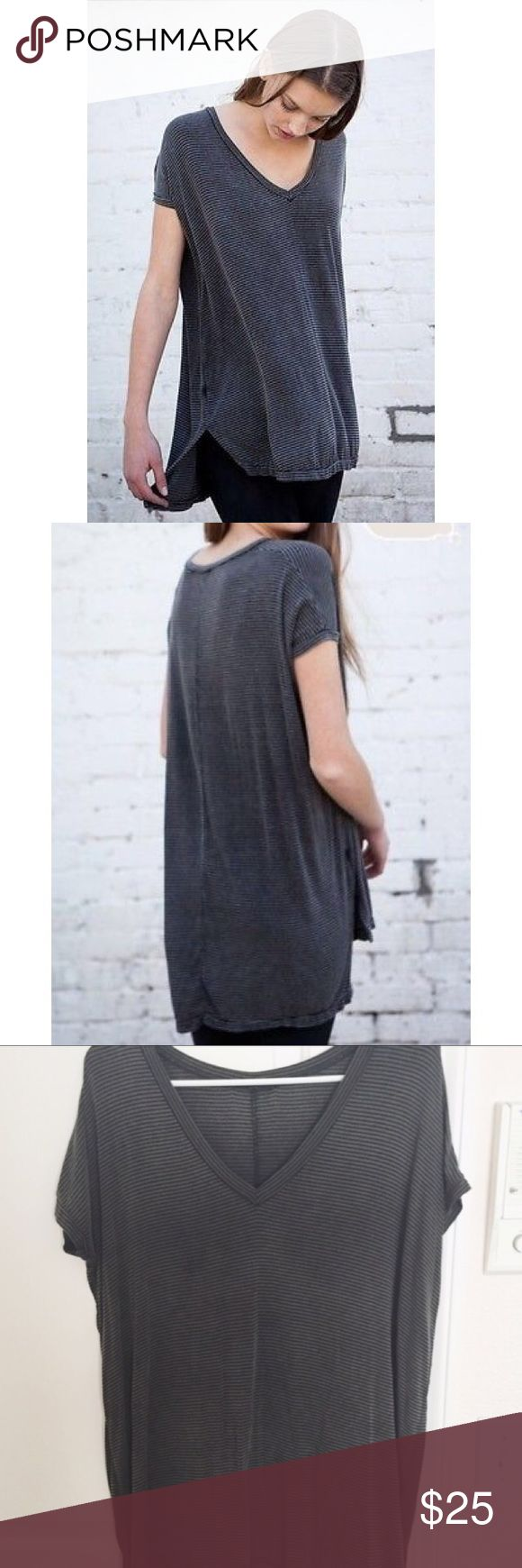 Brandy Melville Milan Top Brandy Melville Milan Top OS  Brandy Melville  Design name: Milan Top Fit: Long Oversized tshirt / long like a tshirt dress Vneck neckline Size: one size Color: Black and charcoal striped Brandy Melville Tops Tees - Short Sleeve