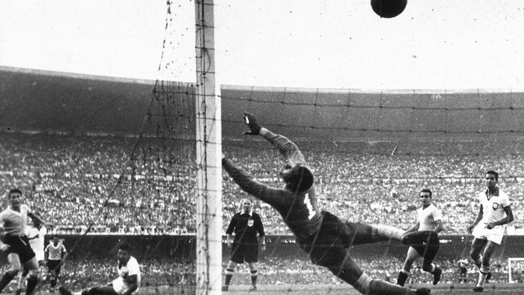 Uruguay's Ghiggia scores the winning goal past the dive of Brazilian goakeeper Barbosa to win the World Cup for Uruguay and complete a major by upset by beating hosts and favourites Brazil. Bob Thomas/Popperfoto/Getty Images