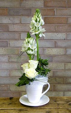 Cup and saucer flower design -Ornithogalum flowers white Roses and Ivy leaves   Flower arranging by Chrissie Harten