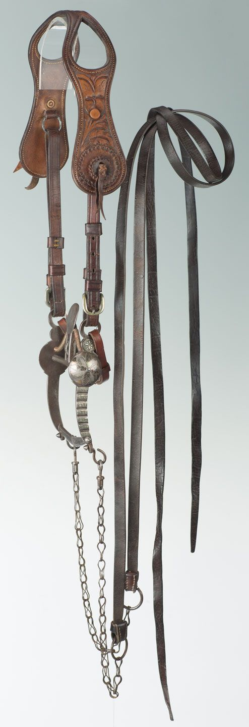 """Early, rare headstall with California spade bit. Marked on crownpiece, """"R.T. FRAZIER/PUEBLO, COLO."""" Brian Lebel's Old West Auction. June 11, 2016. Est. $1,400-1,800."""