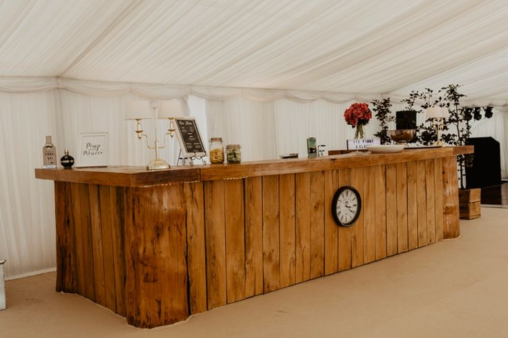 The most beautiful bar I've ever seen and it's homemade! Photo by Benjamin Stuart Photography #weddingphotography #bar #pimmsoclock #pimpyourpimms #wood #carpentry #handmade #diywedding #receptiondecor