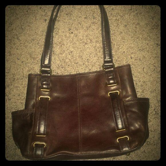 TIGNANELLO LEATHER HANDBAG Very nice TIGNANELLO dark brown leather handbag in very good condition.  Inside of the TIGNANELLO handbags are beautifully done. Tignanello Bags