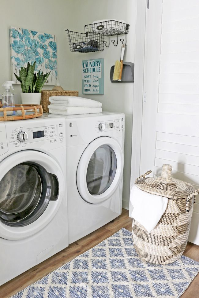 A Cute Organized Laundry Room In A Closet With Images Tiny