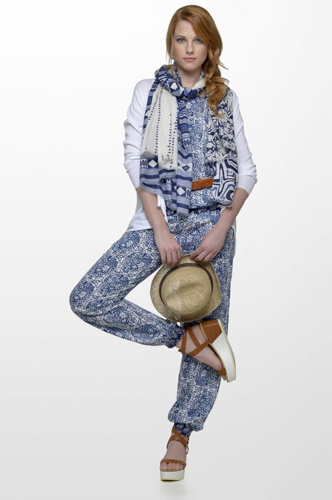 Sarah Lawrence - sleeveless printed top, asymmetrical long sleeve knitted cardigan, draw string printed loose trouser, printed scarf, leather belt.