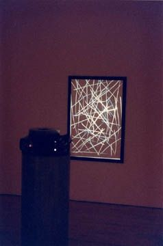 """""""Recombinant"""" uses as a fixed reference, a framed bas-relief, its etched lines reminiscent of the Walking Woman's torso. Onto this marked rectangular surface are projected 80 slides. Michael Snow, """"Recombinant,"""" 1992, Art Gallery of Ontario."""