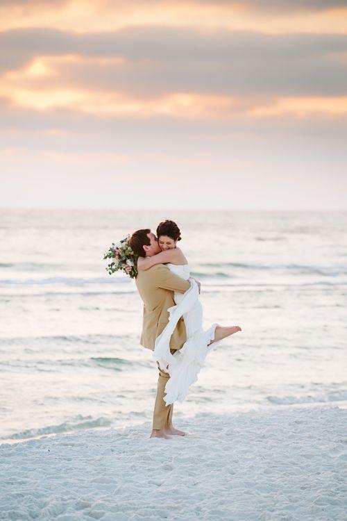 A joyous photo after a seaside ceremony