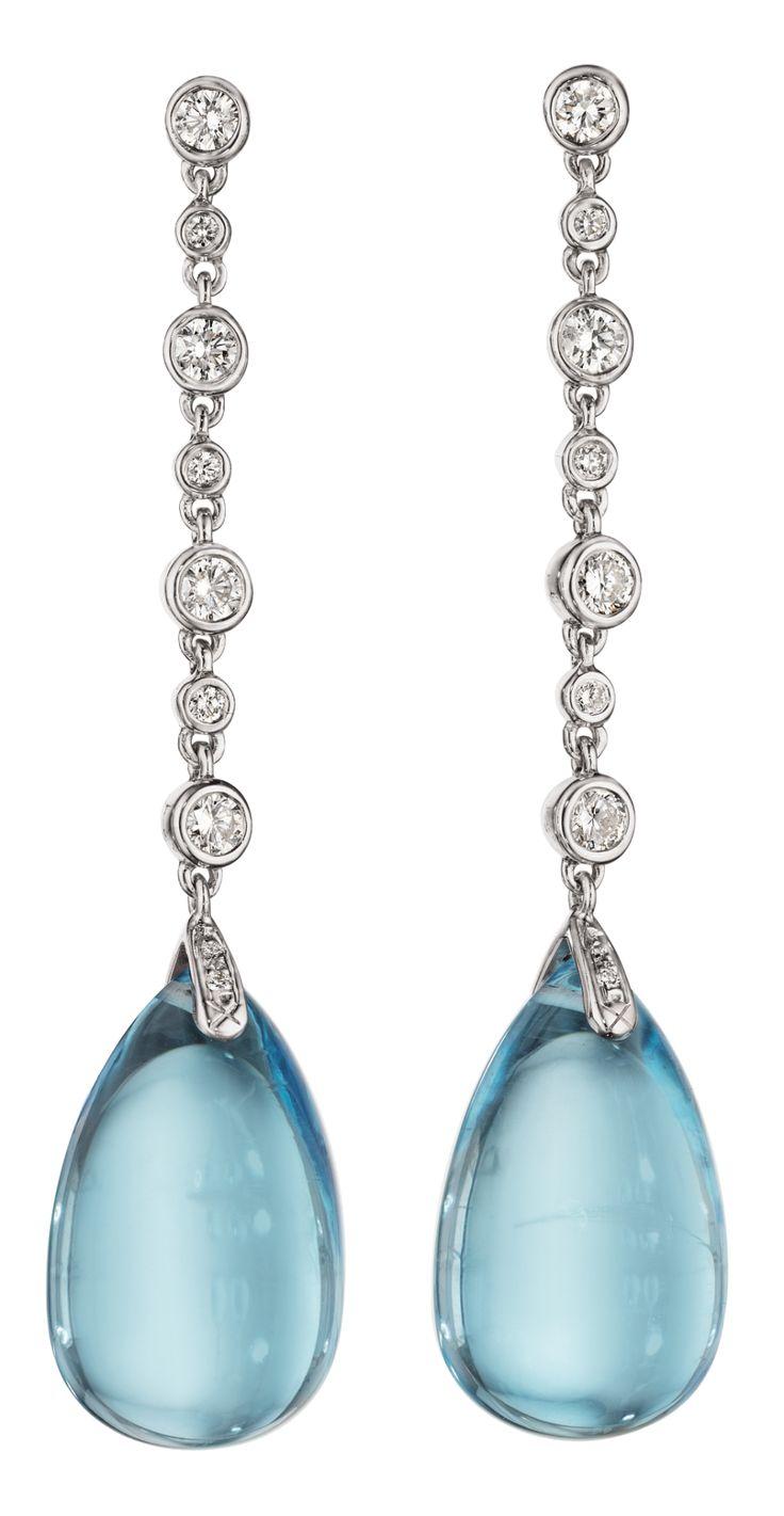 Classic blue topaz and diamond earrings. Such beau…