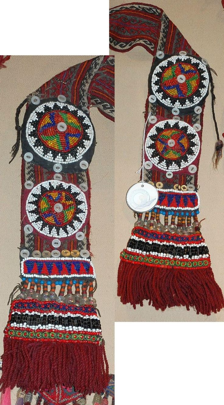 Adorned ends of a women's 'çarpana kemer' (card-woven belt), which is part of a traditional costume from the Damal and Hanak districts (Ardahan province). Woollen tassels, buttons and glass bead work. 2nd half of 20th century, and still in use. Ethnic group: Alevi Türkmen.