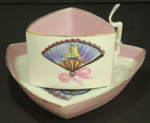 LIMOGES TRIANGULAR CUP AND SAUCER:
